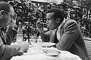 Lunch interview of Harry Belafonte with Art Buchwald of the New York Herald Tribune in Le Fouquet's an upscale french café on Avenue George V in Paris.<br /> <br /> <br /> Entrevue déjeuner de Harry Belafonte avec Art Buchwald du New York Herald Tribune. Le Fouquet est un café français haut de gamme sur l'avenue George V<br /> à Paris.