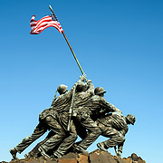 Massive statue on top of the Iwo Jima Memorial (formally the Marine Corps War Memorial) in Arlington, Virginia, next to Arlington National Cemetery. The monument was designed by Felix de Wledon and is based on an iconic Associated Press photo called the Raising the Flag on Iwo Jima by Joe Rosenthal. It was dedicated in 1954.