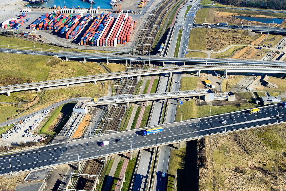 Nederland, Zuid-Holland, Rotterdam, 18-02-2015. A15 en knooppunt Benelux. Infrastructuur bundel, kruising Betuweroute en A15, metro en leidingenviaduct. Ccontainerterminal van ECT. <br /> Motorway A15 junction, connecting Port of Rotterdam with hinterland. Freight railway, subway, pipe overpass. Shortsea hub. <br /> luchtfoto (toeslag op standard tarieven);<br /> aerial photo (additional fee required);<br /> copyright foto/photo Siebe Swart