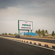 """A highway sign saying """"Popular""""."""