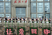 WUHAN, CHINA - OCTOBER 15:<br /> <br />  123 couples participate in a group wedding ceremony on a playground near Science Building at Wuhan University on October 15, 2016 in Wuhan, Hubei Province of China. The 123 couples graduated from Wuhan university hold a group wedding in presence of their headmaster Li Xiaohong to celebrate the 123rd anniversary of Wuhan University.<br /> ©Exclusivepix Media