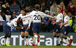 Tottenham Hotspur's Son Heung-min (second left) and teammates celebrate their first goal of the match during the Premier League match at the King Power Stadium, Leicester.