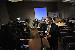 South Bend Mayor Stephen Luecke does a television interview following a news conference to announce the name of Ignition Park at the Century Center in South Bend, IN...Photo by Matt Cashore..