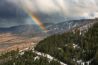 I was hiking in the Bighorn Mountains when it started to rain and the sun threatened to peak out at the same time. It was late enough in the day to make it perfect rainbow weather, I just had to reach the top of the ridge before it happened. A 2nd shower rolled out of the mountains after I reached this view, and a partial rainbow appeared. The trail conditions were very changeable, ranging from soft thigh-deep snow, to packed ice, to mud, to dry ground. Even though the Red Grade Trail system isn't very long, I definitely had to earn the view on this day.