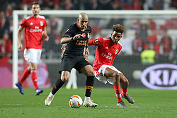 February 21, 2019 - Lisbon, Portugal - Sofiane Féghouli of Galatasaray AS (L) vies for the ball with Gedson Fernandes of SL Benfica (R) during the Europa League 2018/2019 footballl match between SL Benfica vs Galatasaray AS. (Credit Image: © David Martins/SOPA Images via ZUMA Wire)