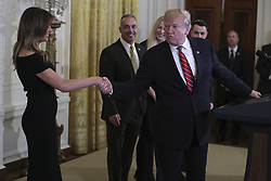 President Donald Trump shakes hands with first lady Melania Trump during a Hanukkah reception in the East Room of the White House on December 6, 2018 in Washington, DC. (Photo by Oliver Contreras/SIPA USA)