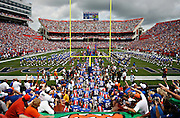 [PHOTO # 4 ]  <br /> <br /> 09 01 2007 - GAINESVILLE - The Gators stream through the tunnel and take the field to open the 2007 season as defending national champions.<br /> <br /> BRIAN CASSELLA | Times<br /> <br /> STORY SUMMARY - Western Kentucky at University of Florida Gators to open the 2007 season at Ben Hill Griffin Stadium.