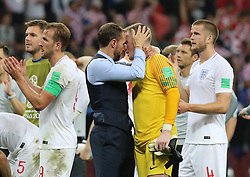 MOSCOW, July 11, 2018  England's head coach Gareth Southgate (3rd L) comforts goalkeeper Jordan Pickford after the 2018 FIFA World Cup semi-final match between England and Croatia in Moscow, Russia, July 11, 2018. Croatia won 2-1 and advanced to the final. (Credit Image: © Yang Lei/Xinhua via ZUMA Wire)