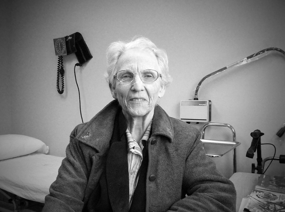 B&W photos of mom in the doctor's office being tested for dementia