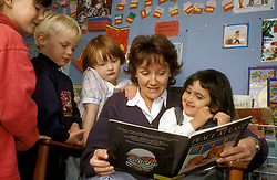Story time in preschool nursery, UK