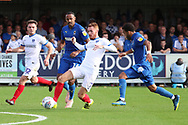 Portsmouth midfielder Tom Naylor (7) passing the ball during the EFL Sky Bet League 1 match between AFC Wimbledon and Portsmouth at the Cherry Red Records Stadium, Kingston, England on 13 October 2018.