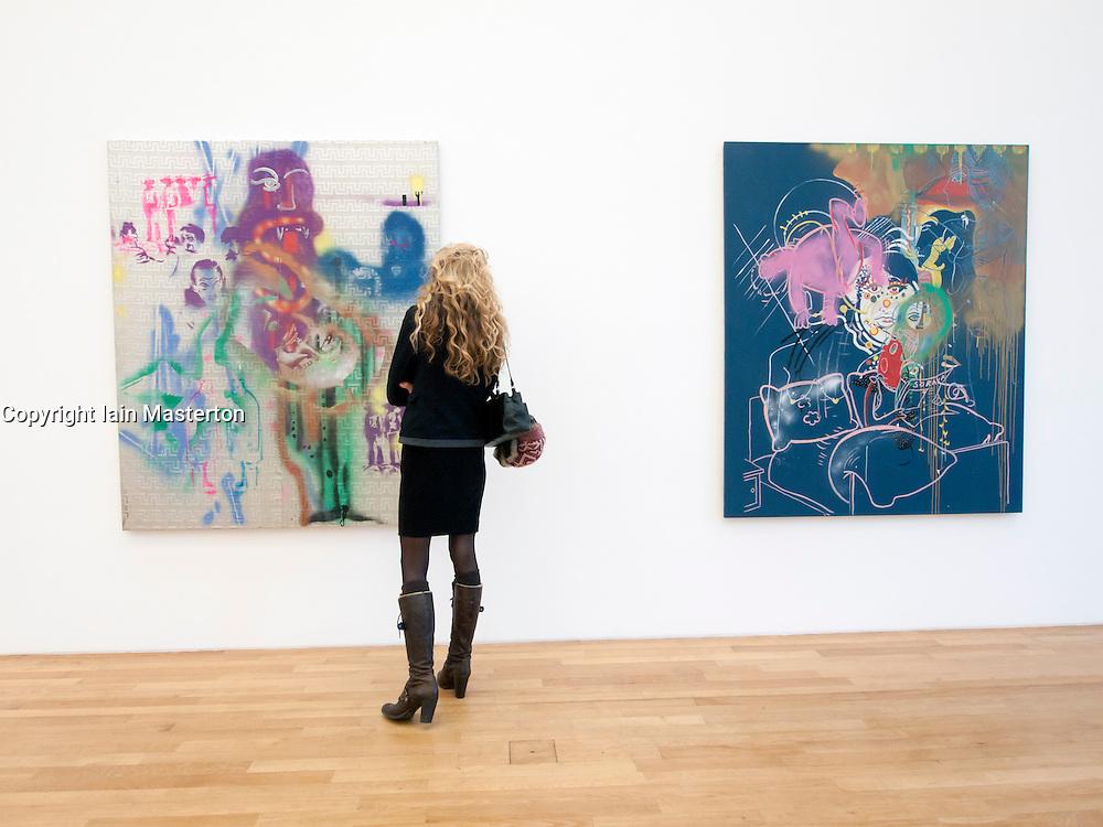 Woman looking at modern art paintings at Bonn Kunstmuseum or Art Museum in Germany