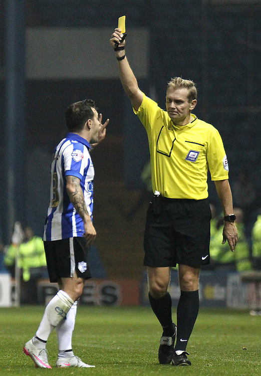 Sheffield Wednesday's Ross Wallace is shown a yellow card by referee Graham Scott<br /> <br /> Photographer Rich Linley/CameraSport<br /> <br /> Football - Capital One Cup Round 4 - Sheffield Wednesday v Arsenal - Tuesday 27th October 2015 - Hillsborough - Sheffield<br />  <br /> © CameraSport - 43 Linden Ave. Countesthorpe. Leicester. England. LE8 5PG - Tel: +44 (0) 116 277 4147 - admin@camerasport.com - www.camerasport.com