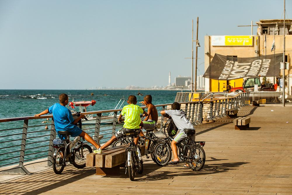 Arab-Israeli children watch a view of the Mediterranean sea in Jaffa port