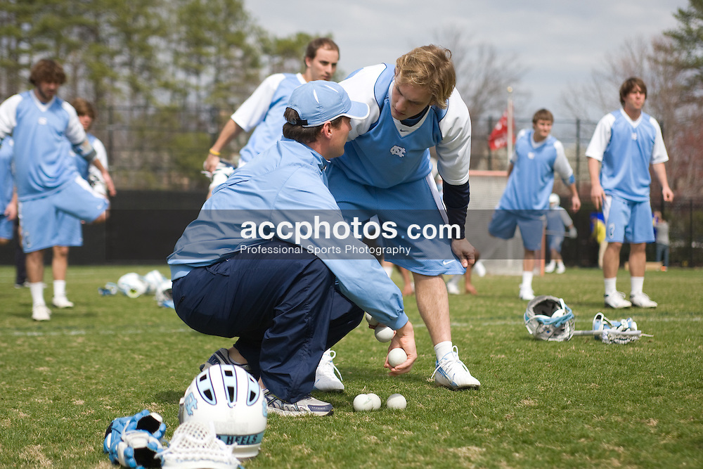 15 March 2008: North Carolina men's lacrosse assistant coach Judd Lattimore with attackman Gavin Petracca (14) before a 19-9 loss to the Duke Blue Devils at Koskinen Stadium in Durham, NC.