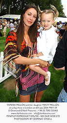TAMARA MELLON and her daughter MINTY MELLON at a dog show in London on 6th July 2004.PWY 59