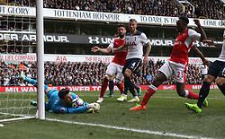30 April 2017 London : Premier League Football : Tottenham Hotspur v Arsenal :<br /> Tottenham goalkeeper Hugo Lloris dives on the ball as Danny Welbeck stretches to challenge for the ball.<br /> Photo: Mark Leech