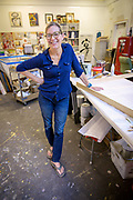 Vicki Vinton in her Oxford, Pa. studio preparing for an upcoming exhibit at the Somerville - Manning Gallery.  Photograph by Jim Graham