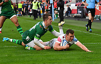 Rugby Union - 2020 / 2021 Gallagher Premiership - Round 19 - London Irish vs Exeter Chiefs - Brentford Community Stadium<br /> <br /> Exeter Chiefs' Joe Simmonds evades the tackle of London Irish's Tom Parton to score his sides 2nd try.<br /> <br /> COLORSPORT