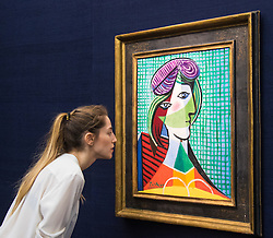 Sotheby's, London, January 28th 2016. A woman admires Picasso's Tête De Femme, valued at between £16 - 20 million, to be auctioned by Sotheby's in London as part of their sale of Impressionist, Modern, Surrealist and Contemporary art. ///FOR LICENCING CONTACT: paul@pauldaveycreative.co.uk TEL:+44 (0) 7966 016 296 or +44 (0) 20 8969 6875. ©2015 Paul R Davey. All rights reserved.///FOR LICENCING CONTACT: paul@pauldaveycreative.co.uk TEL:+44 (0) 7966 016 296 or +44 (0) 20 8969 6875. ©2015 Paul R Davey. All rights reserved.