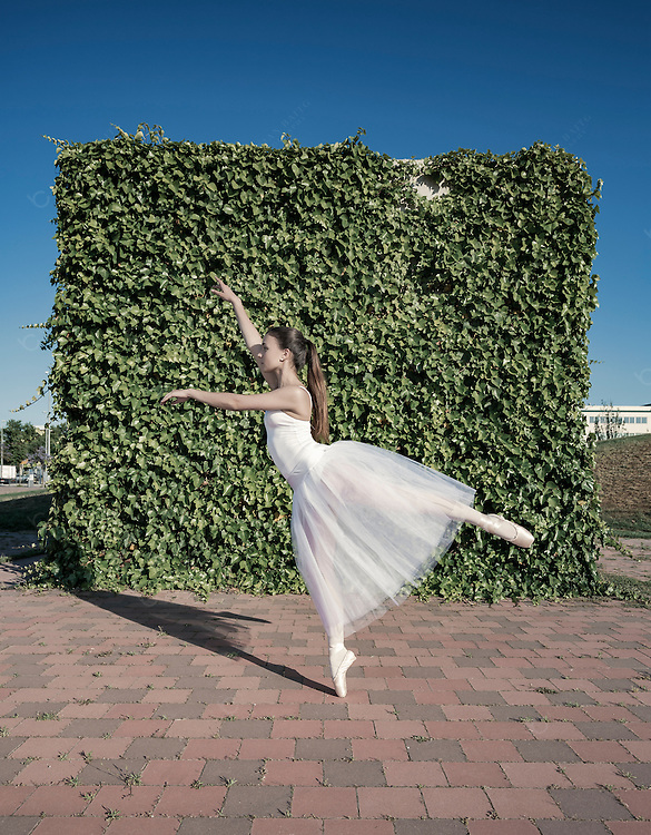 Young ballet dancer performance in urban park