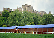 © under license to London News Pictures. LONDON, UK  11/05/2011. A rider heads toward the show ground. The first day of The Royal Windsor Horse Show in the private grounds of Windsor Castle today (11 May 2011). Photo credit should read Stephen Simpson/LNP.