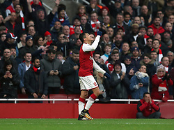 Arsenal's Alexis Sanchez celebrates scoring his side's second goal of the game during the Premier League match at the Emirates Stadium, London.