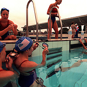 The USA Synchronised swimming team prepare for a practice session at Auburn Swimming Pool, Sydney, Australia.