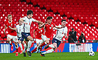 LONDON, ENGLAND - MARCH 31: Harry Maguire of England competes with Krzysztof Piatek of Poland during the FIFA World Cup 2022 Qatar qualifying match between England and Poland on March 31, 2021 in London, United Kingdom. Sporting stadiums around the UK remain under strict restrictions due to the Coronavirus Pandemic as Government social distancing laws prohibit fans inside venues resulting in games being played behind closed doors. (Photo by Wlosek/PressFocus/MB Media)