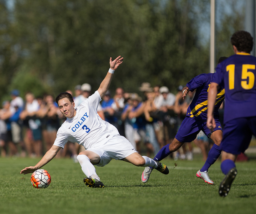 Jansen Aoyama of Colby College is fouled during a NCAA Division III soccer game against Williams College on September 19, 2015 in Waterville, ME. (Dustin Satloff/Colby College Athletics)