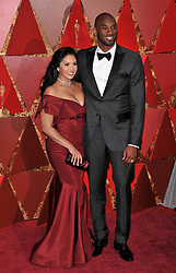 Kobe Bryant and Vanessa Laine Bryant walking on the red carpet during the 90th Academy Awards ceremony, presented by the Academy of Motion Picture Arts and Sciences, held at the Dolby Theatre in Hollywood, California on March 4, 2018. (Photo by Sthanlee Mirador/Sipa USA)