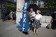 Pro Brexit protester with a Brexit map of the UK strapped to his back in Westminster as inside Parliament the Tory leadership race continues on 17th June 2019 in London, England, United Kingdom.