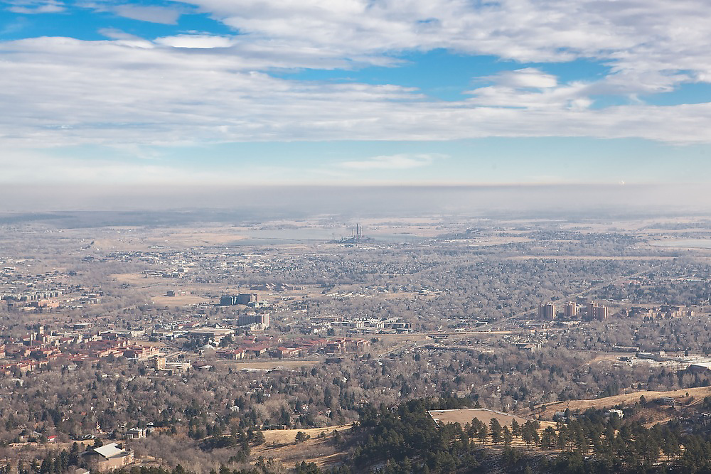 View over Boulder, University of Colorado and the coal-powered Valmont Power Plant from Chautauqua Park, Boulder, Colorado.