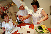 """Lenotre Ecole Culinaire, Paris,..short course - """"Return to the Market"""" with Chef Jacky Legras..stuffing the zucchini flowers with a mixture of rice and vegetables..photo by Owen Franken for the NY Times..July 12, 2007......."""