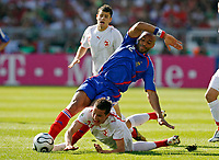Photo: Glyn Thomas.<br />France v Switzerland. Group G, FIFA World Cup 2006. 13/06/2006.<br /> France's Thierry Henry (C) is tackled by Philipp Degen (bottom).