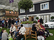ON LEFT: THE ARC BY GREEN UNIT IS AN ECO FRINDLY MODULar space IN BACKGROUND ON RIGHT ' TRADITIONALLY BRITISH HOME, Ideal Home Show, sponsored by Zoopla, Olympia. London. 19 March 2016