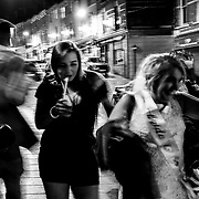A bride to be and maid of honor spend Saturday night making their way down Waterloo Street. Northern Ireland, September 2019