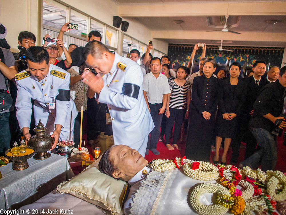 12 OCTOBER 2104 - BANG BUA THONG, NONTHABURI, THAILAND: Representatives of the Royal Family at the funeral rites for Apiwan Wiriyachai started at Wat Bang Phai in Bang Bua Thong, a Bangkok suburb, Sunday. Apiwan was a prominent Red Shirt leader, member of the Pheu Thai Party of former Prime Minister Yingluck Shinawatra, and a member of the Thai parliament. The military government that deposed the elected government in May, 2014, charged Apiwan with Lese Majeste for allegedly insulting the Thai Monarchy. Rather than face the charges, Apiwan fled Thailand to the Philippines. He died of a lung infection in the Philippines on Oct. 6. The military government gave his family permission to bring him back to Thailand for the funeral. He will be cremated later in October. The first day of the funeral rites Sunday drew tens of thousands of Red Shirts and their supporters, in the first Red Shirt gathering since the coup.    PHOTO BY JACK KURTZ