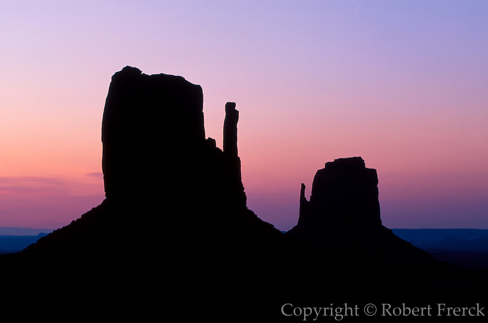 ARIZONA, MONUMENT VALLEY TRIBAL PARK Spectacular sandstone buttes with the famous West Mitten, left; the East Mitten, right; at sunrise