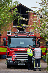 © Licensed to London News Pictures.  20/05/2013. MILTON KEYNES, UK. A fire engine remains at the scene of a fatal house fire in St Leger Court, Great Lindford, Milton Keynes. Police were called at 7.58pm last night (19/5) by Buckinghamshire Fire and Rescue Service to a fire at a residential address where an occupant died. A 57-year-old man has been arrested on suspicion of murder and remains in custody. Photo credit: Cliff Hide/LNP