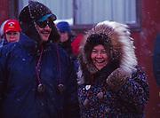 Couple on Front Street enjoying the finish of the Iditarod Sled Dog Race, Nome, Alaska.