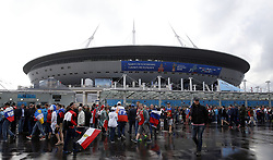 Fans arrive for the FIFA World Cup 2018, Group A match at Saint Petersburg Stadium. PRESS ASSOCIATION Photo. Picture date: Tuesday June 19, 2018. See PA story WORLDCUP Russia. Photo credit should read: Owen Humphreys/PA Wire. RESTRICTIONS: Editorial use only. No commercial use. No use with any unofficial 3rd party logos. No manipulation of images. No video emulation.