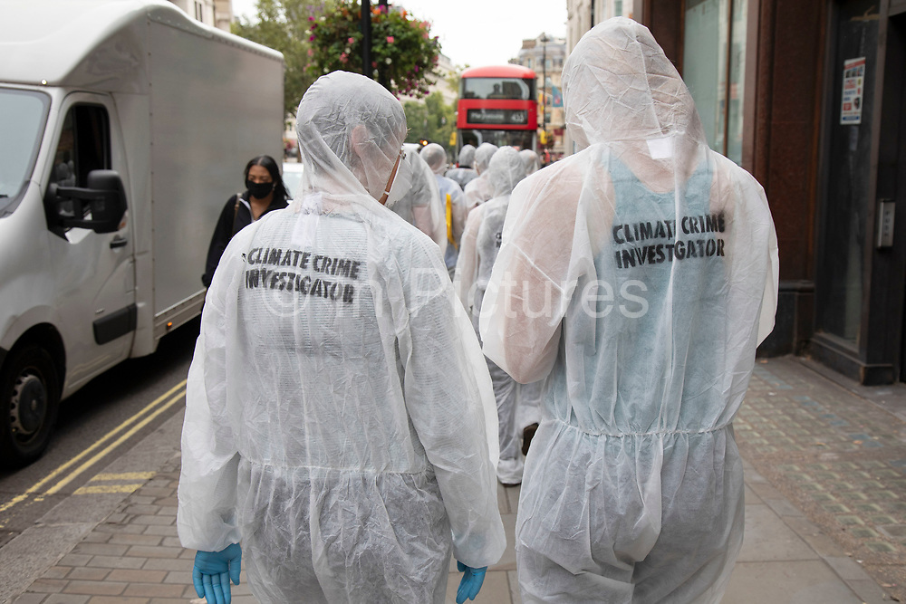 Extinction Rebellion 'crime scene investigators' in white suits and masks walking to investigate areas of ecocide in a performance on 7th September 2020 in London, United Kingdom. The 20 investigators were protesting at the Brazilian government's alleged involvement in ecocide in the Amazon, and the UK government's ecocide along the HS2 route. Extinction Rebellion is a climate change group started in 2018 and has gained a huge following of people committed to peaceful protests. These protests are highlighting that the government is not doing enough to avoid catastrophic climate change and to demand the government take radical action to save the planet.