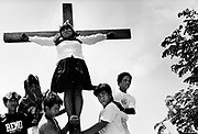 Pilgrims are crucified as part of the Easter, Holy Week celebrations. Kapitangan, Bulacan Province. The Philippines.