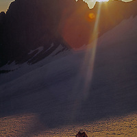 Mountaineer crosses Palisade Glacier below Mount Gayley.