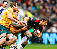 Ben Foden of England is tackled by David Pockock and Rocky Elsom of Australia during the Investec series international between England and Australia at Twickenham, London, on Saturday 13th November 2010. (Photo by Andrew Tobin/SLIK images)