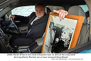 Paidi OSe with a photo of Dolly Parton whom he hoped to drivew to Ventry..Picture by Don MacMonagle