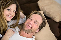 Happy couple relaxing on couch