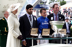 The Princess Royal presents the winners trophy to jockey William Buick for the King's Stand Stakes after winning on Blue Point during day one of Royal Ascot at Ascot Racecourse.