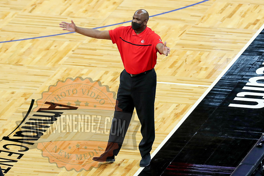 ORLANDO, FL - MARCH 03: Atlanta interim head coach Nate McMillan argues a call against the Orlando Magic during the first half at Amway Center on March 3, 2021 in Orlando, Florida. NOTE TO USER: User expressly acknowledges and agrees that, by downloading and or using this photograph, User is consenting to the terms and conditions of the Getty Images License Agreement. (Photo by Alex Menendez/Getty Images)*** Local Caption *** Nate McMillan